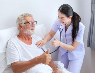 nurse and senior man doing thumbs up