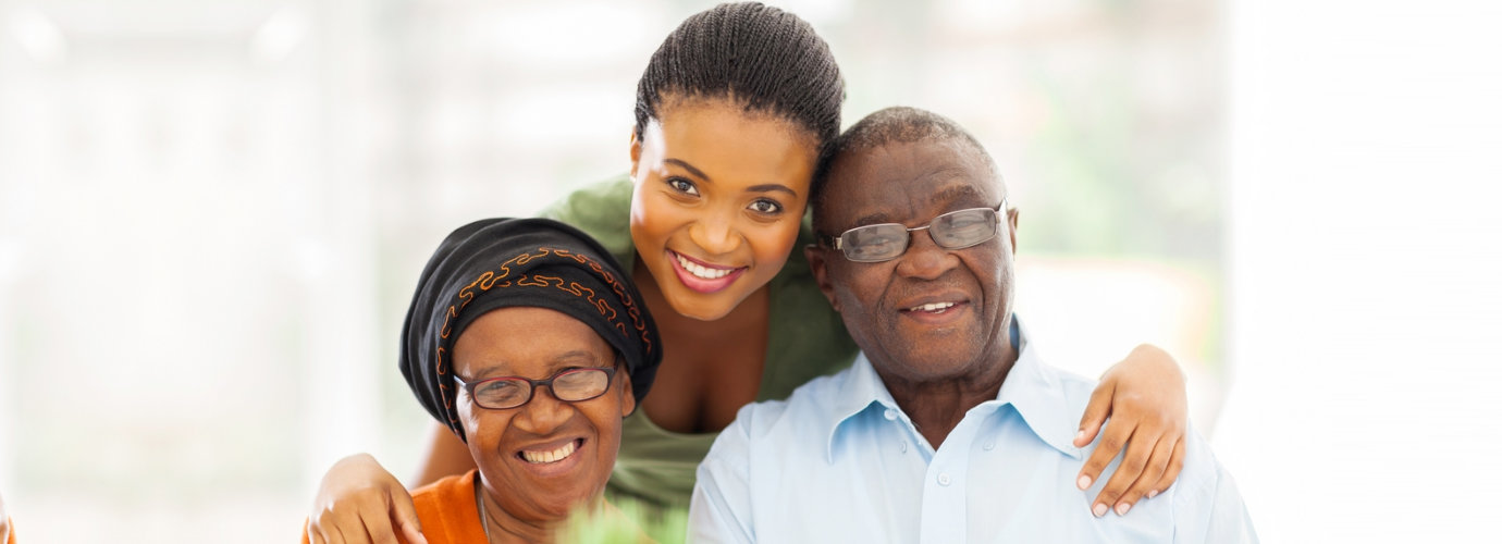 adult woman and senior couple smiling
